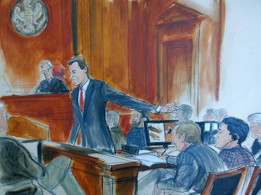 "In this courtroom sketch, Assistant U.S. Attorney David Denton points at defendant Mehmet Hakan Atilla, right, during opening arguments of a trial, Tuesday, Nov. 28, 2017, in New York federal court. Denton said Atilla, deputy CEO of Halkbank, was the architect of a ""massively successful"" scheme to dupe U.S. banks into letting Iran move money around the world. Judge Richard Berman is seated at the bench, background left. (Elizabeth Williams via AP)"