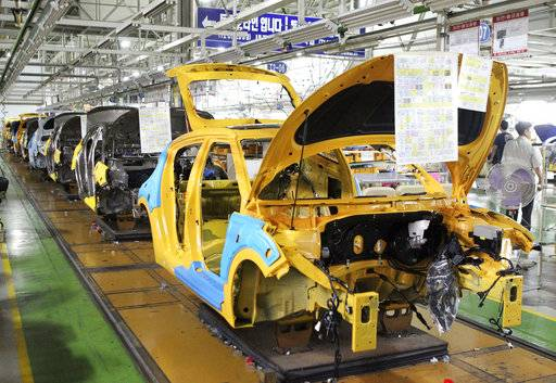 FILE - In this July 13, 2012, file photo, assembly lines sit idle at the Hyundai Motor factory in Ulsan, South Korea. Hyundai Motor Co. union spokesman Hong Jae-gwan said Tuesday, Nov. 28, 2017, that about 1,950 workers, or 4 percent of its union members, stopped work Monday at a plant in Ulsan, 380 kilometers (236 miles) southeast of Seoul. He said there was no plan to expand the partial strike into a full-blown one. (Lee Sang-hyun/Yonhap via AP, File)