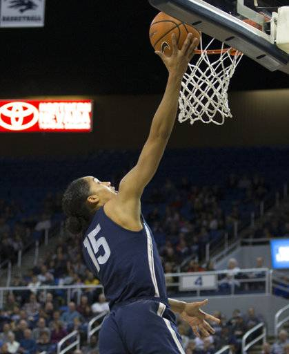 Connecticut's Gabby Williams shoots against Nevada in the first half of an NCAA college basketball game in Reno, Nev. Tuesday, Nov. 28, 2017. Williams grew up in the Reno-Sparks area and was a standout player at Reed High School. (AP Photo/Tom R. Smedes)