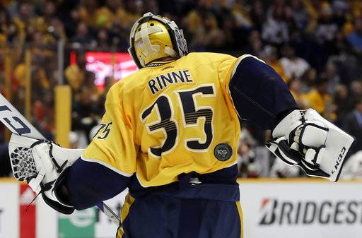 Nashville Predators goalie Pekka Rinne, of Finland, shakes the puck loose after it got caught in his uniform in the first period of an NHL hockey game against the Chicago Blackhawks Tuesday, Nov. 28, 2017, in Nashville, Tenn. (AP Photo/Mark Humphrey)