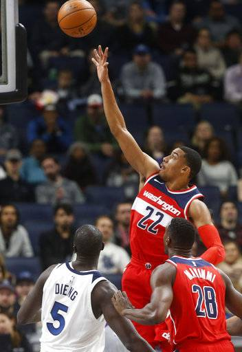 Washington Wizards' Otto Porter Jr. (22) shoots as Minnesota Timberwolves' Gorgui Dieng, left, of Senegal looks on in the first half of an NBA basketball game Tuesday, Nov. 28, 2017, in Minneapolis. (AP Photo/Jim Mone)