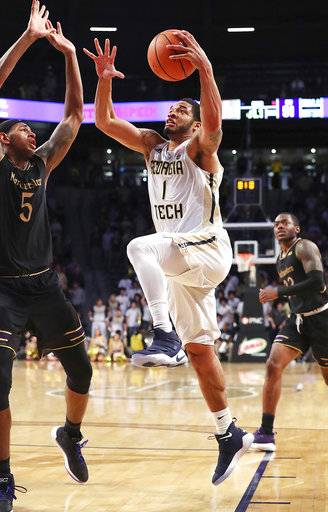 Georgia Tech guard Tadric Jackson goes up for the game winning shot over Northwestern center Dererk Pardon in an NCAA college basketball game in Atlanta on Tuesday, Nov. 28, 2017. Georgia Tech won, 52-51. (Curtis Compton/Atlanta Journal-Constitution via AP)