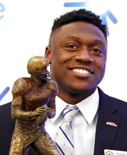 Mississippi wide receiver A.J. Brown poses with the Conerly Trophy awarded to Mississippi's top college football player, following a ceremony in Jackson, Miss., Tuesday, Nov. 28, 2017. (AP Photo/Rogelio V. Solis)