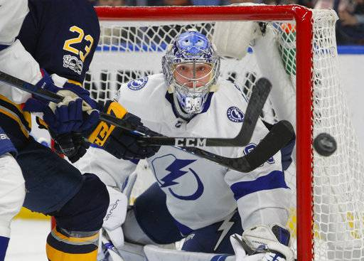 Tampa Bay Lightning goalie Andrei Vasilevskiy (88) keeps his eyes on the puck during the first period of an NHL hockey game against the Buffalo Sabres, Tuesday Nov. 28, 2017, in Buffalo, N.Y. (AP Photo/Jeffrey T. Barnes)