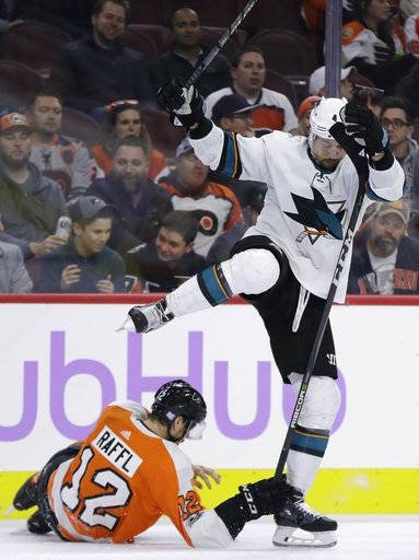 Philadelphia Flyers' Michael Raffl (12) collides with San Jose Sharks' Brenden Dillon (4) during the first period of an NHL hockey game, Tuesday, Nov. 28, 2017, in Philadelphia. (AP Photo/Matt Slocum)