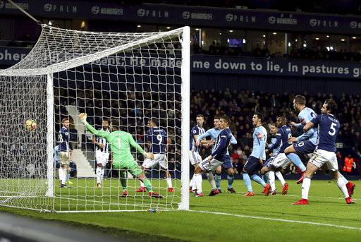 West Bromwich Albion's Jonny Evans scores an own goal against Newcastle United during the English Premier League soccer match at The Hawthorns, West Bromwich, England, Tuesday Nov. 28, 2017. (David Davies/PA via AP)