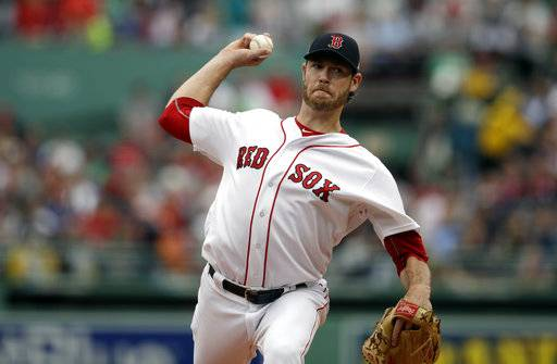 In this Sunday, Oct. 8, 2017 file photo, Boston Red Sox starting pitcher Doug Fister delivers during the first inning of Game 3 of baseball's American League Division Series against the Houston Astros in Boston. Free agent right-hander Doug Fister has signed a $4 million deal with the Texas Rangers, who are still in the market for more starting pitching. The Rangers announced the deal Tuesday, Nov. 28, 2017 after Fister had completed a physical.(AP Photo/Charles Krupa, File)