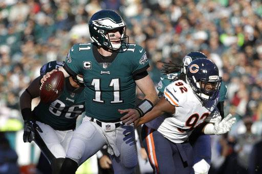 Philadelphia Eagles' Carson Wentz looks to pass during the first half of an NFL football game against the Chicago Bears, Sunday, Nov. 26, 2017, in Philadelphia. (AP Photo/Michael Perez)