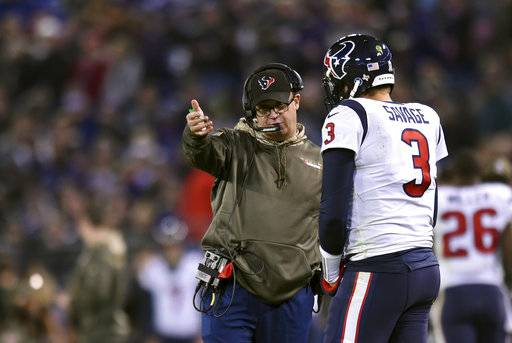 Houston Texans head coach Bill O'Brien, left, speaks with quarterback Tom Savage in the first half of an NFL football game against the Baltimore Ravens, Monday, Nov. 27, 2017, in Baltimore. (AP Photo/Gail Burton)
