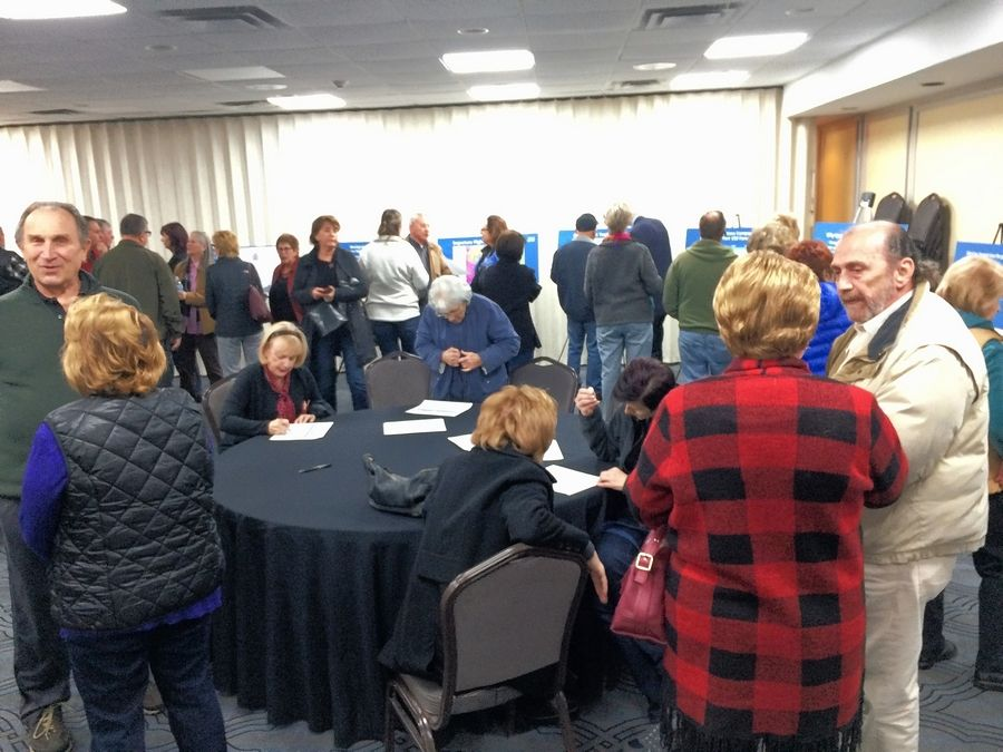 A steady stream of visitors provided comments and asked questions at an open house Tuesday night at the Ramada Plaza Chicago North Shore hotel in Prospect Heights regarding a proposed soundproofing plan for homeowners near Chicago Executive Airport in Wheeling.