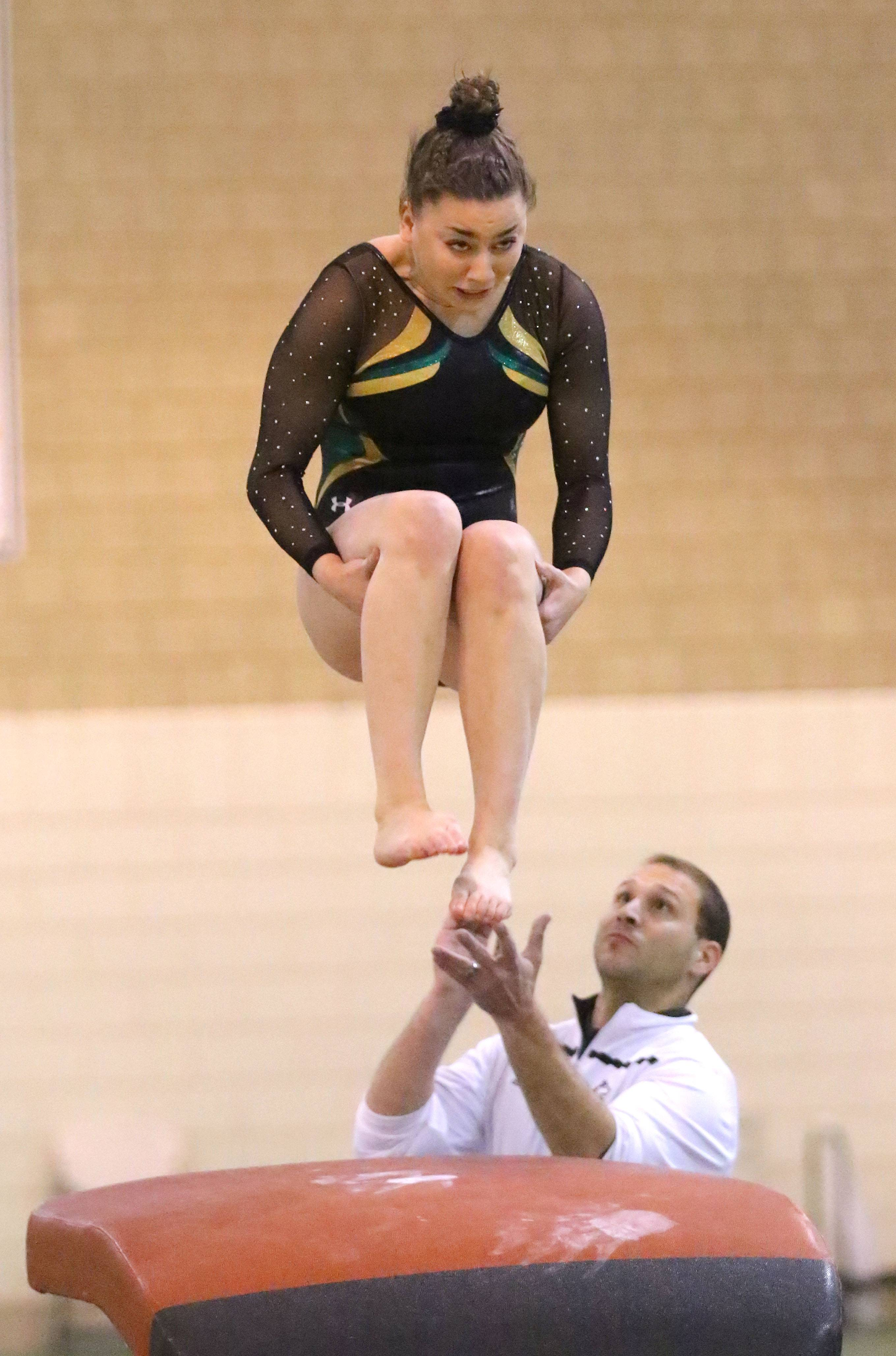 Stevenson's Hannah Brand competes on the vault during girls gymnastics action Wednesday at Stevenson.