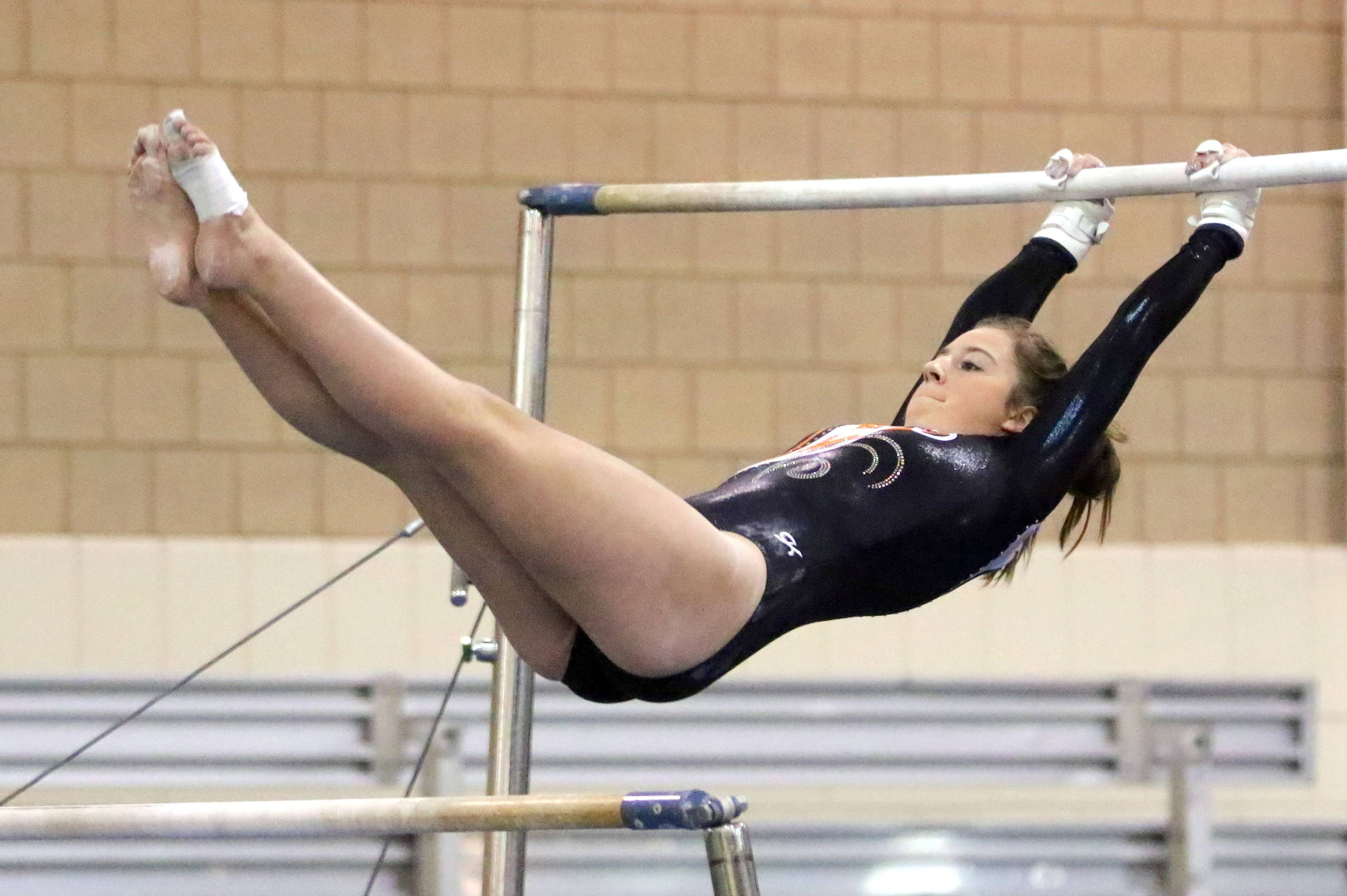Libertyville's Maddie Swanson competes on the uneven bars Wednesday at Stevenson.