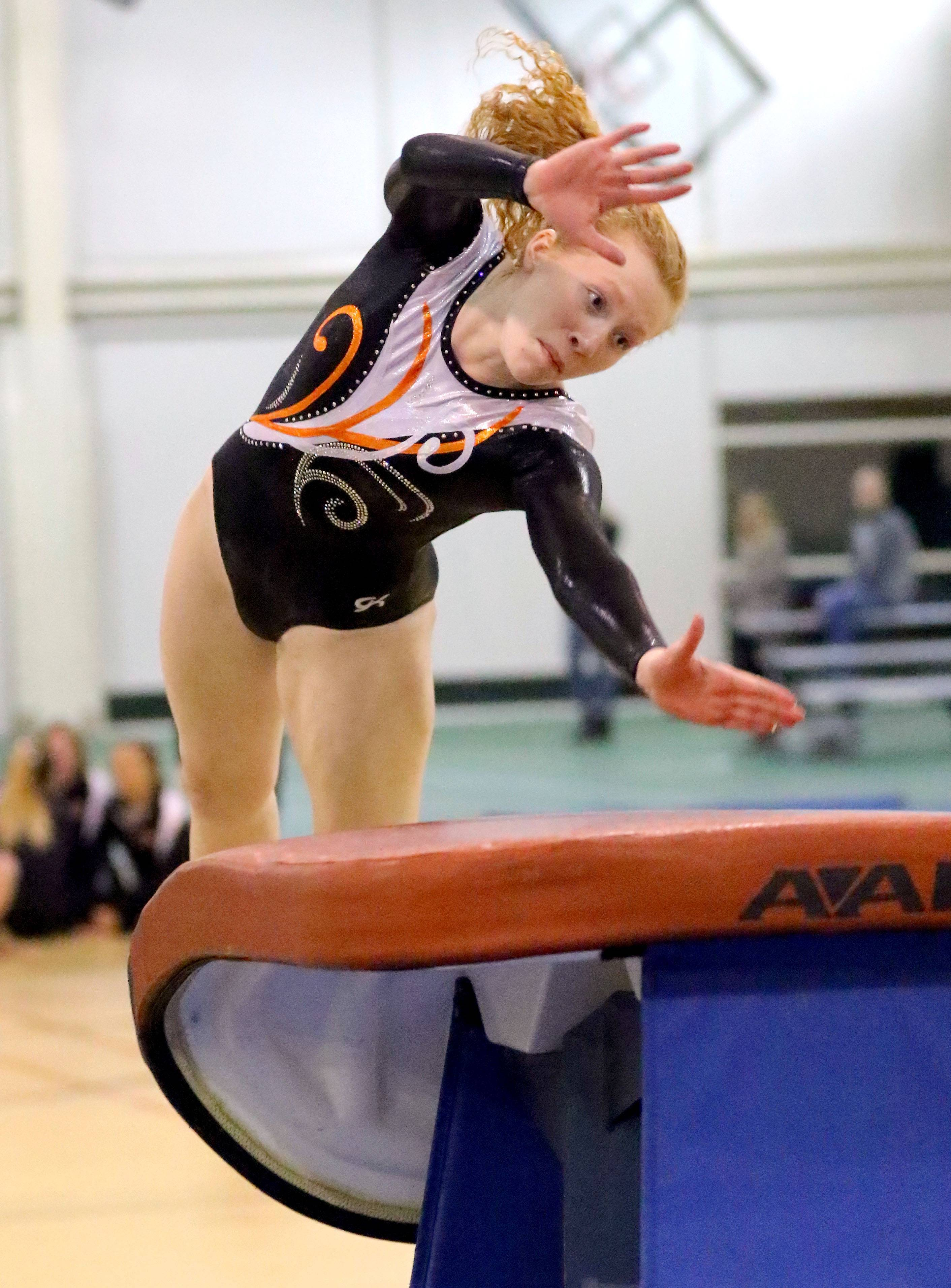 Libertyville's Claire Neuberger competes on the vault Wednesday at Stevenson.