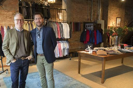 In this Tuesday, Nov. 21, 2017, photo, designer Peter Manning, left, and Jeff Hansen, CEO of Peter Manning, pose for a photo in the Peter Manning showroom in New York. The clothing retailer for men 5 feet 8 inches tall or under, tries to convey to shoppers that it offers quality at a fair price.