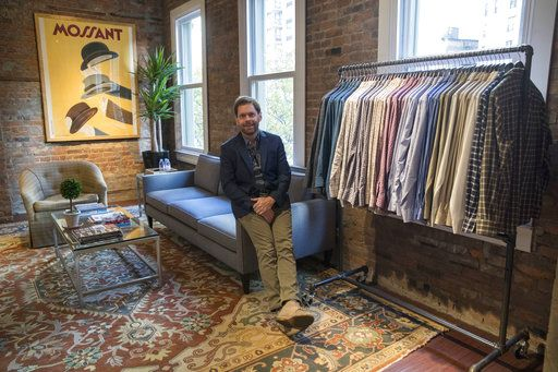 In this Tuesday, Nov. 21, 2017, photo, Jeff Hansen, CEO of Peter Manning, poses for a photo in the store's showroom in New York. The clothing retailer for men 5 feet 8 inches tall or under, tries to convey to shoppers that it offers quality at a fair price.