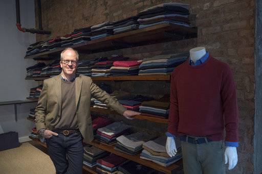 In this Tuesday, Nov. 21, 2017, photo, designer Peter Manning poses for a photo at the Peter Manning NYC showroom in New York. The clothing retailer for men 5 feet 8 inches tall or under, tries to convey to shoppers that it offers quality at a fair price.