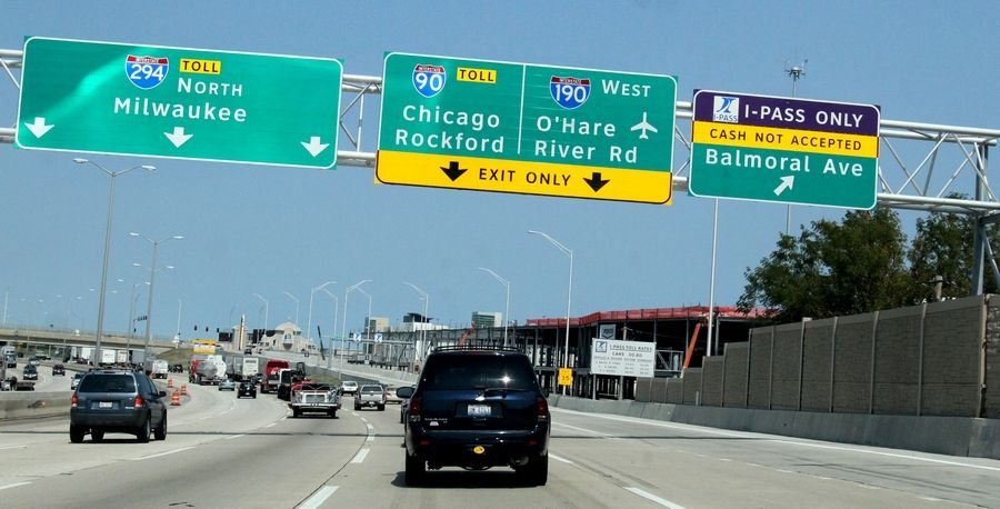 The Illinois tollway approved a $157 million contract to an engineering company that employs the chairman's daughter and a tollway executive's son and has donated to charities run by two tollway directors.