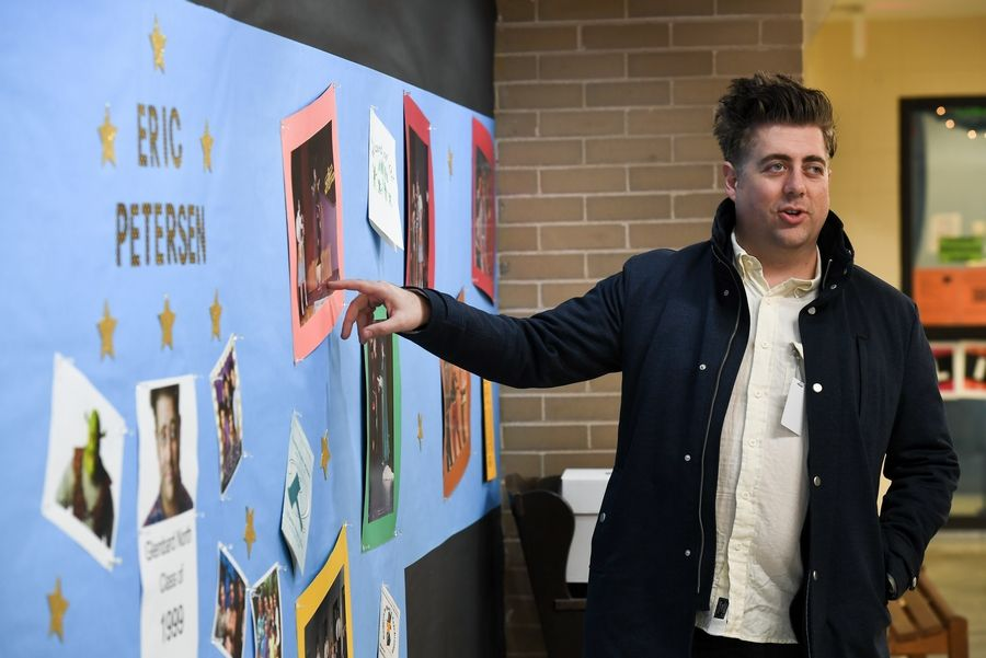 "Eric Petersen, who's currently performing in the Broadway-bound musical, ""Escape to Margaritaville,"" looks over some photos from his Glenbard North stage career."