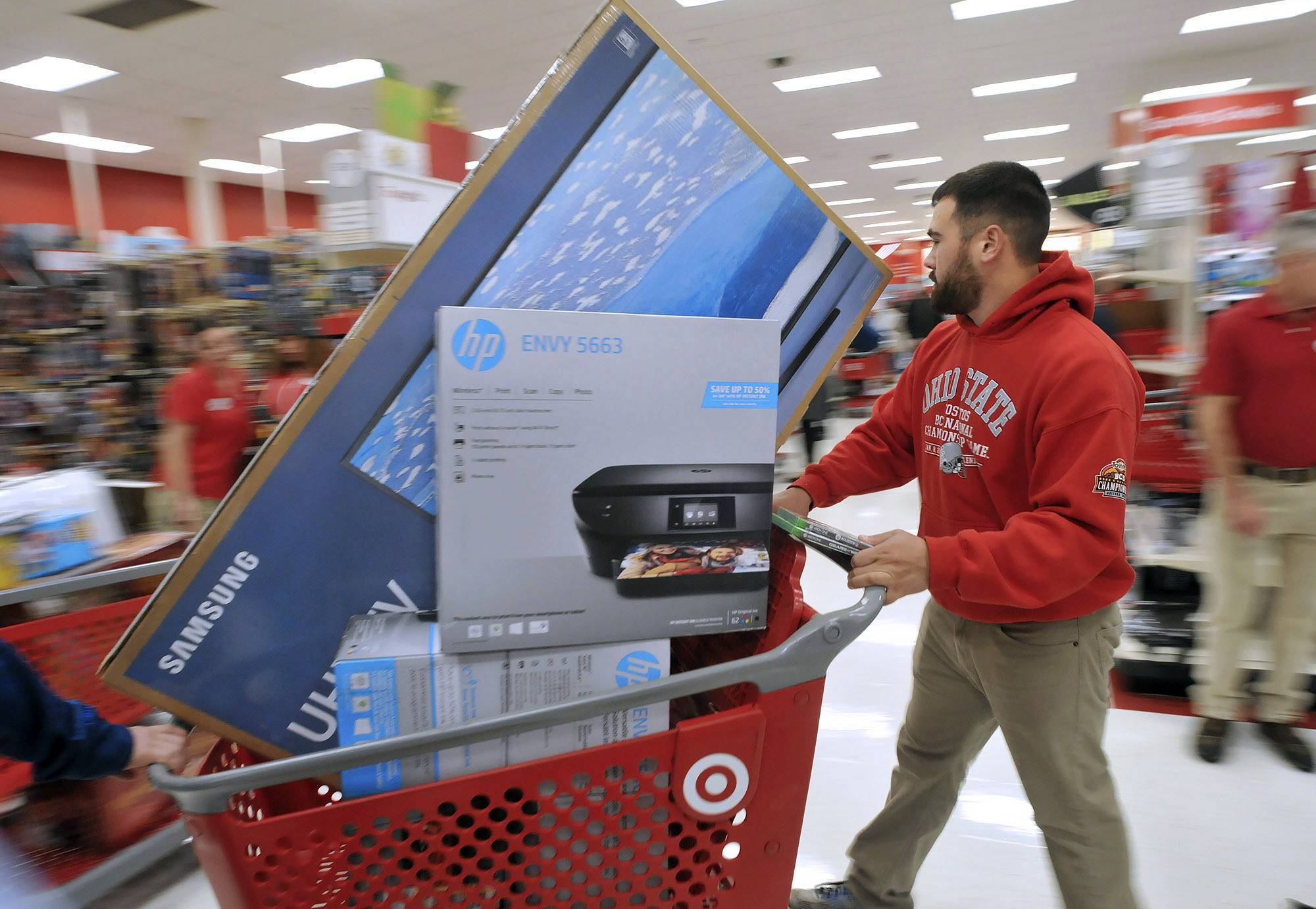 Target is looking to attract more men to its stores and is adding merchandise, from craft beer to clothing, to do so.