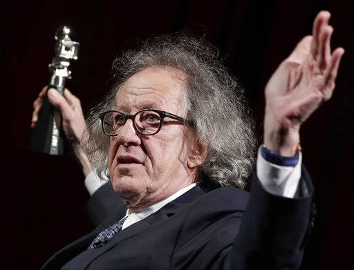 "FILE - In this Feb. 11, 2017 file photo, Australian actor Geoffrey Rush poses with his 'Berlinale Camera Award' wich he received prior to the screening of the film 'Final Portrait' at the 2017 Berlinale Film Festival in Berlin, Germany. The Sydney Theatre Company says it received a complaint of ""inappropriate behavior� against Rush, an allegation lawyers for the Oscar winner denied. The company wasn't disclosing details of the behavior alleged to have occurred while the 66-year-old Australian actor was an employee. Media reports say the allegation dated from the theater's production of ""King Lear,� about two years ago. His lawyers deny Rush was involved in inappropriate behavior. (AP Photo/Michael Sohn, File)"