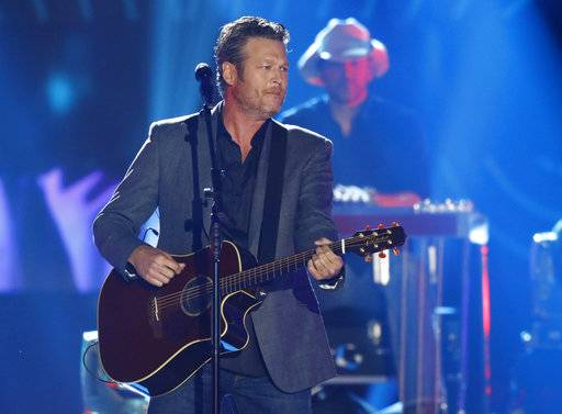 "FILE - In this June 7, 2017 file photo, Blake Shelton performs ""Every Time I Hear that Song"" at the CMT Music Awards at Music City Center in Nashville, Tenn. Shelton recorded a minute-long message that was included in a longer tribute video to the Quaboag Regional Middle/High School students who died in a Nov. 6 car crash in West Brookfield, Mass. Shelton's brother died in a crash nearly three decades ago.(Photo by Wade Payne/Invision/AP, File)"