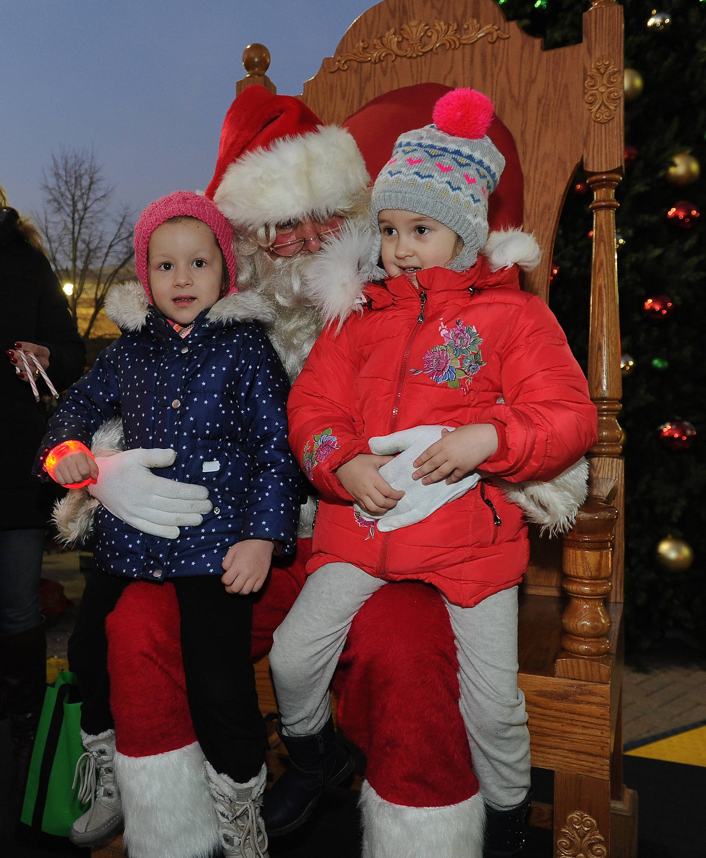 Rebecca Bogilbea, left, and Delia Balanuta, both 4 and from Des Plaines, tell Santa their Christmas wishes Friday night at Des Plaines' annual tree-lighting ceremony in Metropolitan Square.