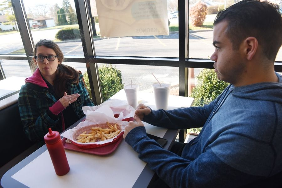 Katherine Pedraza of Mount Prospect and Dennis Sullivan of Des Plaines have lunch Friday at Frankies Fast Food in Mount Prospect. Both said they were glad the Cook County soda tax was repealed.