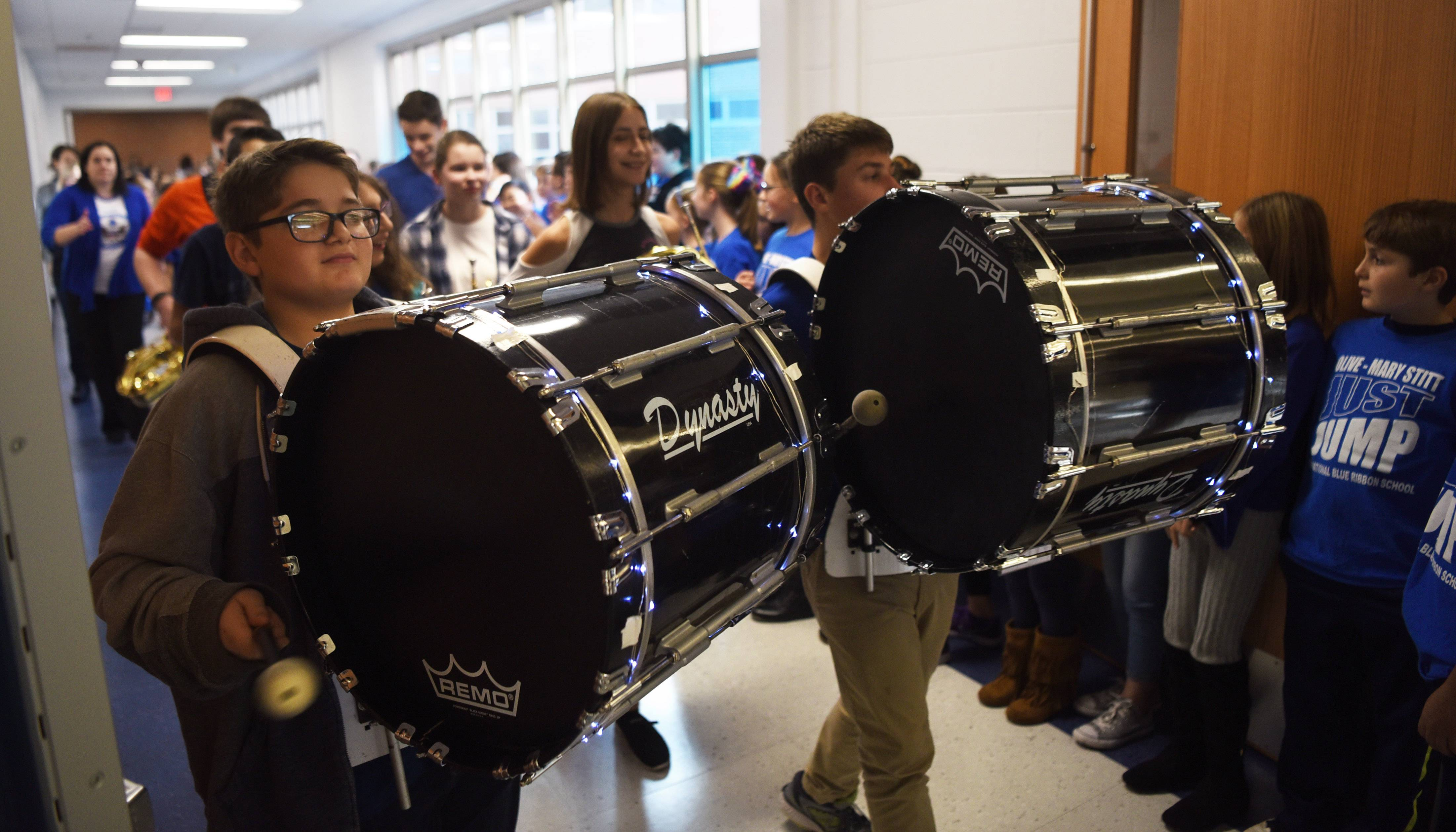 The Thomas Middle School band leads a procession of Olive-Mary Stitt Elementary School students Friday to an assembly celebrating the latter school's Blue Ribbon Award.