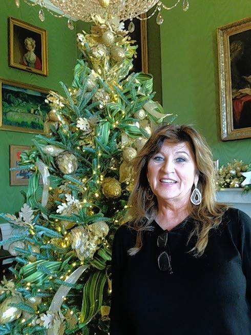 Kim Eggert of Park Ridge helped with the tree in the Green Room, with its handcrafted ornaments all made of paper by fellow volunteers and tucked into yards and yards of green ribbon.