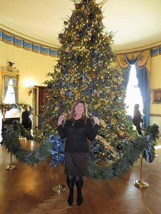 Kim Eggert of Park Ridge was assigned the plum role of trimming the official White House tree -- an 18-foot balsam fir in the Blue Room, which features glass ornaments depicting the seal of each state and territory, as well as large bows fashioned out of blue, silver and gold ribbon.