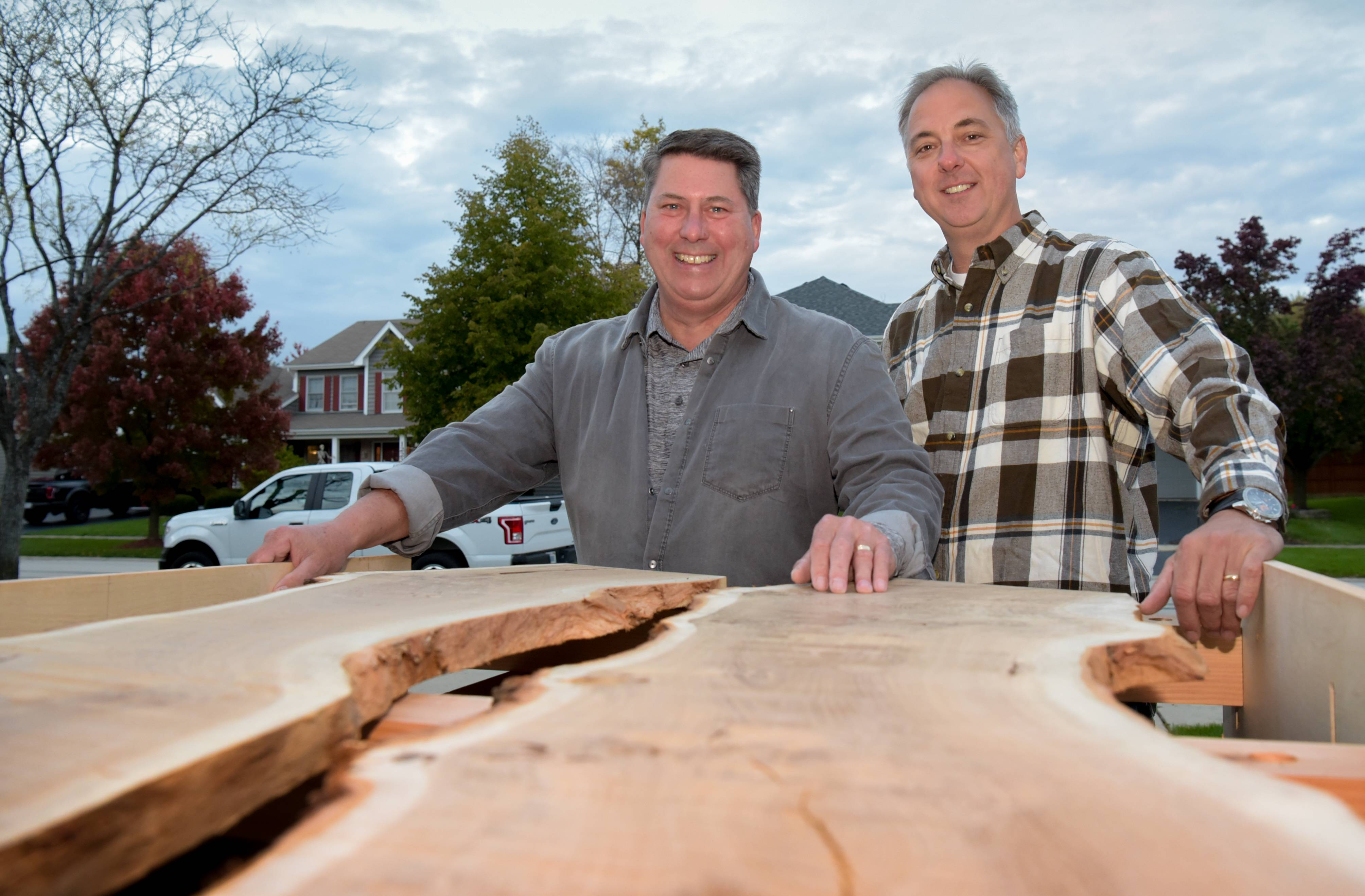 "Naperville neighbors Dave Horton and Perry Martin are working together to make a ""river table"" and other pieces of furniture from wood salvaged from the Hobson Oak. The neighbors say their wives fear they'll love their creations so much they'll have to buy them at charity auctions next year and keep the pieces themselves."