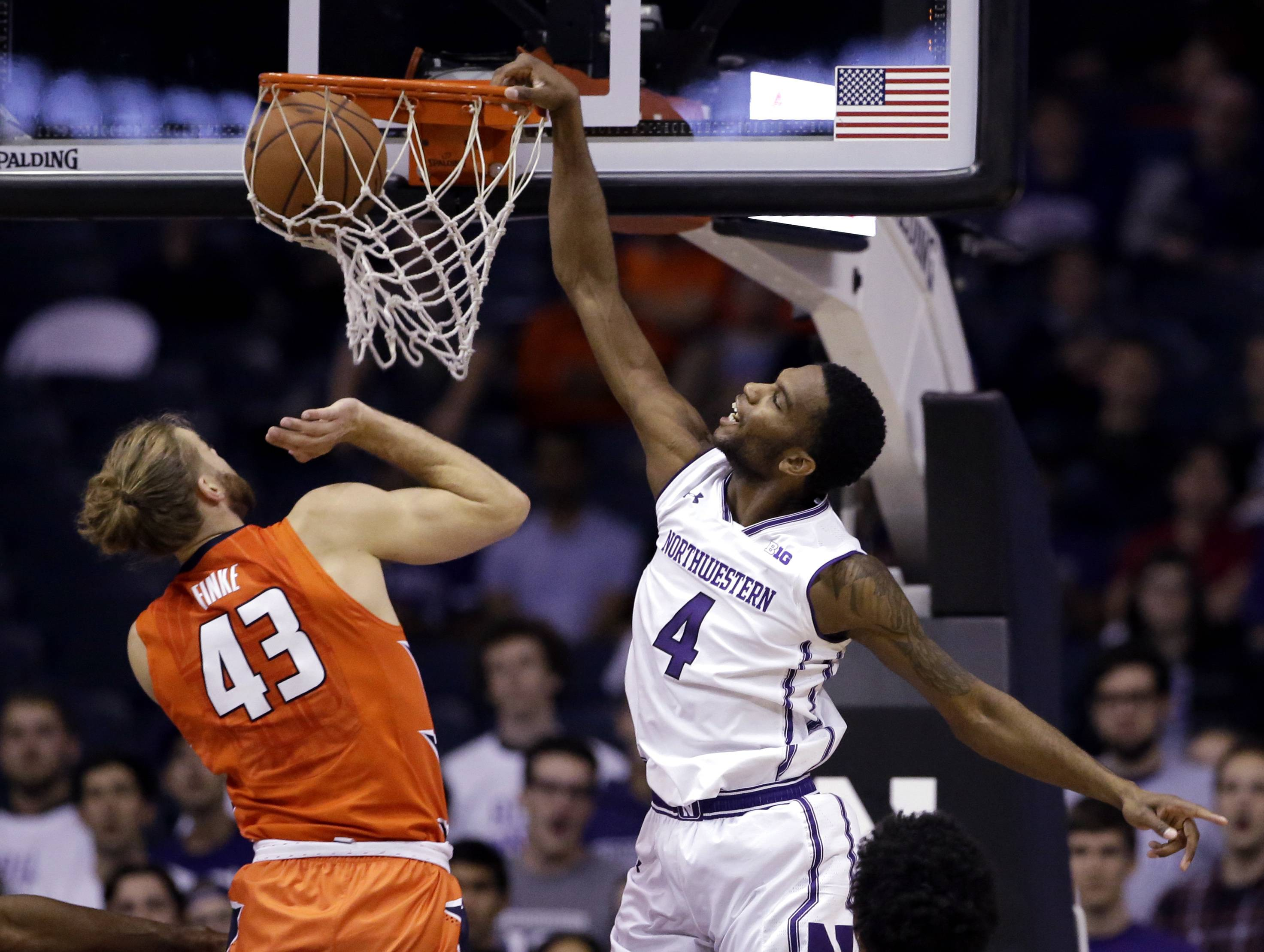 Northwestern forward Vic Law, right, dunks against Illinois forward Michael Finke during the first half of an NCAA college basketball game Friday, Dec. 1, 2017, in Rosemont, Ill. (AP Photo/Nam Y. Huh)