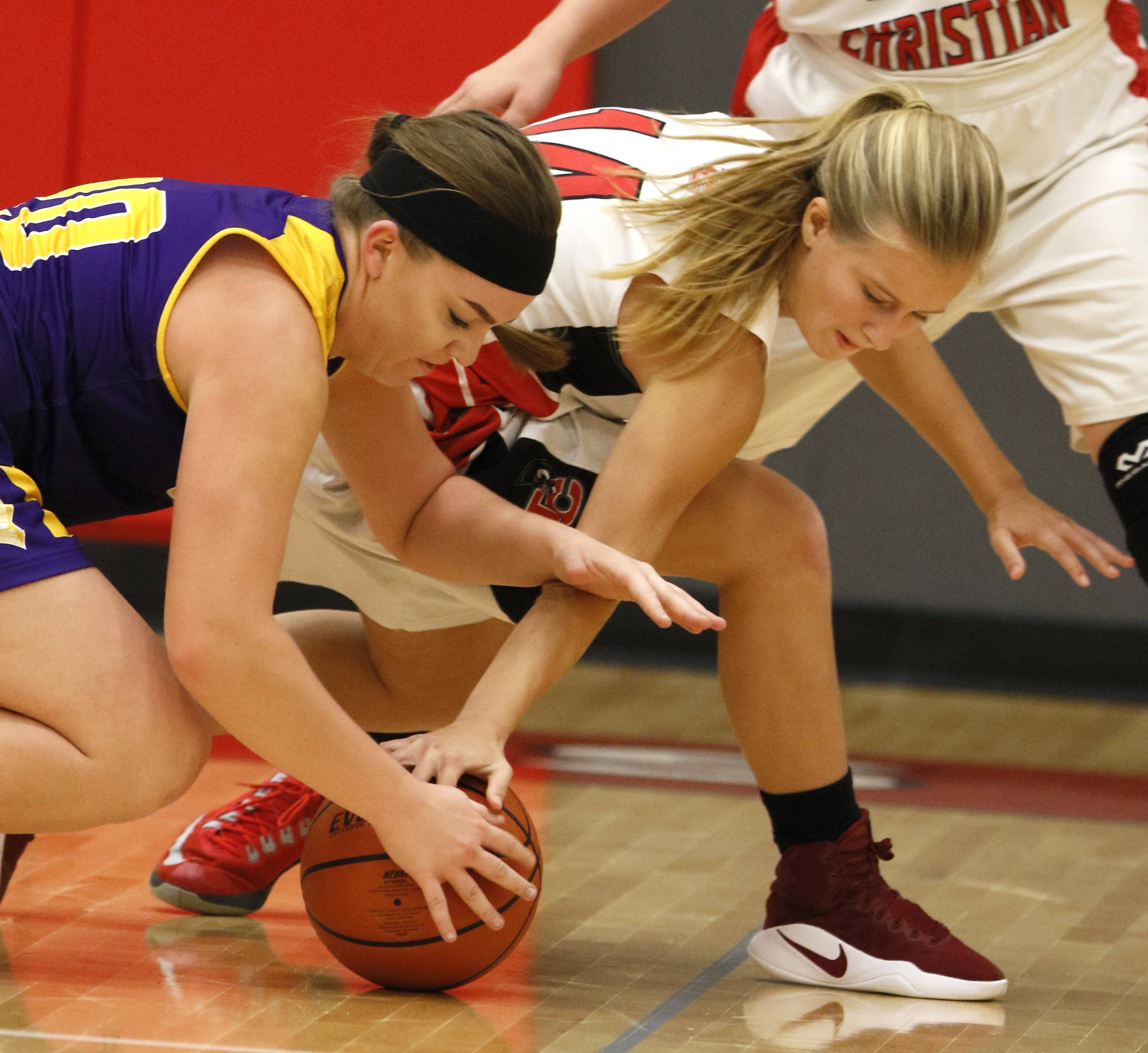 Chicago Christian's Anna Schnyders, left, battles for a loose ball with Timothy Christian's Abby Carstensen, right, during girls basketball action in Elmhurst.