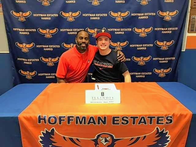 Hoffman Estates senior Declan Rustay, right, and boys track coach Tyrone Jones share the moment as Rustay inks his National Letter of Intent to Illinois on Friday in a ceremony at Hoffman Estates.