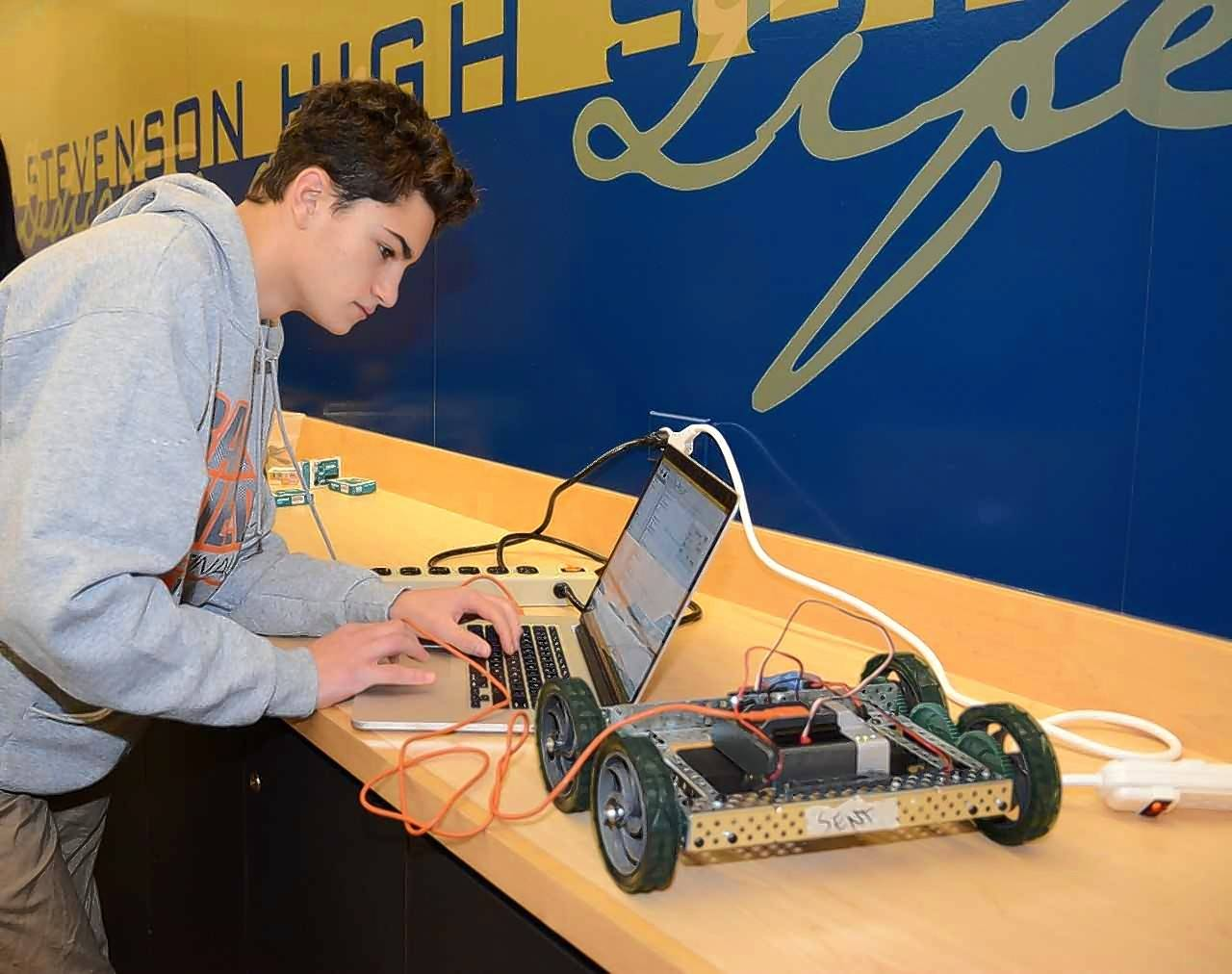 Fremont Middle School student Trevor Abbott programs a device during the Code Fusion event at Stevenson High School. The event allowed SHS-bound students to get some hands-on coding experience.