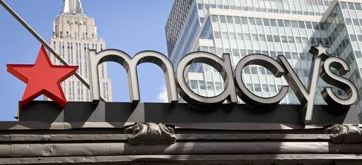 This Tuesday, May 2, 2017, photo shows Macy's corporate signage at its flagship store in Manhattan, in New York. Macy's is hiring an extra 7,000 seasonal associates this holiday season, saying traffic in its department stores nationwide has been high. (AP Photo/Bebeto Matthews)