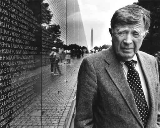 In this May 11, 1995 photo, Vincent Scully, author and Sterling Professor Emeritus of Art in Architecture at Yale University, visits the Vietnam Wall Memorial in Washington, DC. Scully, a revered architecture historian and professor who inspired generations of students ranging from David McCullough to Maya Lin, died Thursday, Nov. 30 2017, at his home in Lynchburg, Va.. He was 97, and had been suffering from Parkinson's disease. (Frank Johnston/The Washington Post via AP)