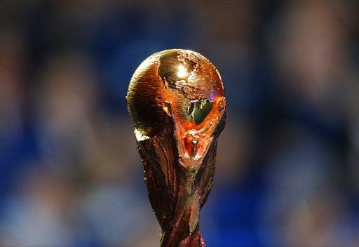 The World Cup trophy is placed on stage during the 2018 soccer World Cup draw in the Kremlin in Moscow, Friday Dec. 1, 2017. (AP Photo/Alexander Zemlianichenko)
