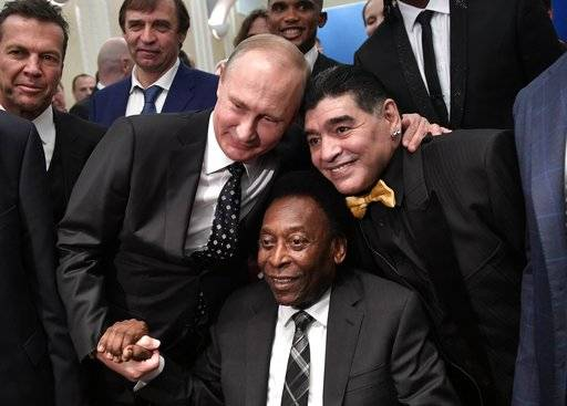 Russian President Vladimir Putin, left, Brazilian soccer legend Pele, center, and Argentinian soccer legend Diego Armando Maradona pose for a photo prior to the 2018 soccer World Cup draw in the Kremlin in Moscow, Friday Dec. 1, 2017. (Alexei Nikolsky, Sputnik, Kremlin Pool Photo via AP)