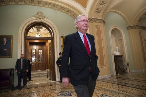 Senate Majority Leader Mitch McConnell, R-Ky., walks from the chamber to his office during votes on amendments to the GOP overhaul of the tax bill, on Capitol Hill in Washington, Friday night, Dec. 1, 2017. (AP Photo/J. Scott Applewhite)