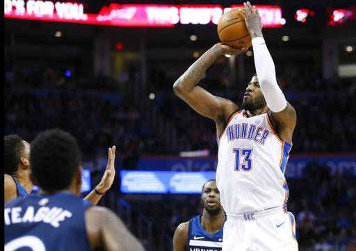 Oklahoma City Thunder forward Paul George (13) shoots against the Minnesota Timberwolves during the second quarter of an NBA basketball game in Oklahoma City, Friday, Dec. 1, 2017. (AP Photo/Sue Ogrocki)