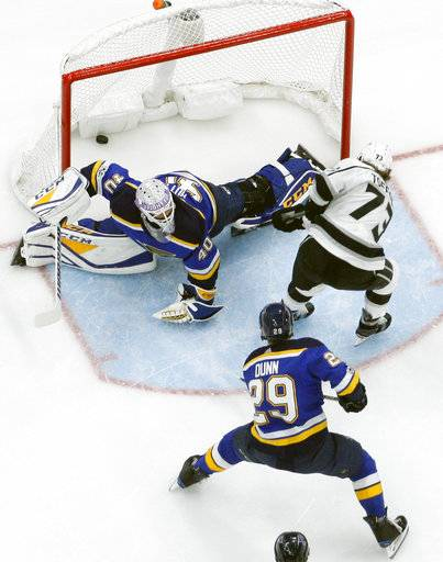 Los Angeles Kings' Tyler Toffoli (73) scores past St. Louis Blues goalie Carter Hutton and Vince Dunn (29) during the first period of an NHL hockey game Friday, Dec. 1, 2017, in St. Louis. (AP Photo/Jeff Roberson)