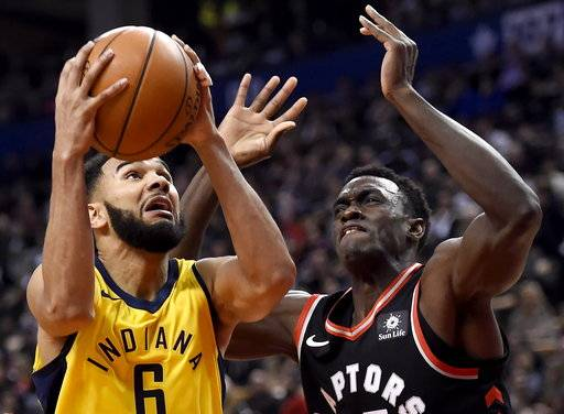 Indiana Pacers guard Cory Joseph (6) drives to the net past Toronto Raptors forward Pascal Siakam (43) (Chris Dillmann/Vail Daily via AP)