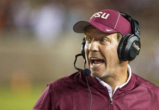 FILE - In this Oct. 29, 2016, file photo, Florida State coach Jimbo Fisher shouts instructions during the team's NCAA college football game against Clemson in Tallahassee, Fla. Two people with direct knowledge of the decision say Fisher has resigned to take the same job at Texas A&M. Fisher handed in his resignation after a meeting with university President John Thrasher on Friday, Dec. 1, 2017. according to the people who spoke on condition of anonymity because Florida State had not announced the move. (AP Photo/Mark Wallheiser, File)