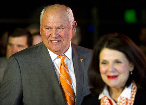 Phillip Fulmer follows University of Tennessee Chancellor Beverly Davenport into a press conference, Friday, Dec. 1, 2017, in Knoxville, Tenn., where he was named athletic director at the university. The university placed former AD John Currie on paid leave amid what has been a tumultuous and embarrassing football coaching search. (Calvin Mattheis/Knoxville News Sentinel via AP)