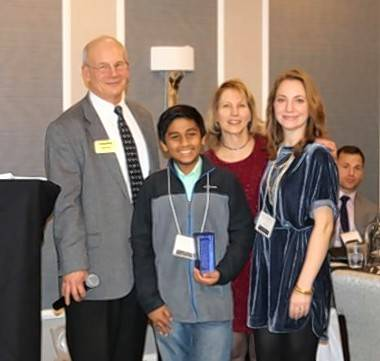 Palatine Area Chamber of Commerce Director Steve Gauss, chamber President Jan Wood and office manager Maggie Morris present Mohnish Soni with the Rising Star award Friday night at the Keys to Success dinner at The Grand at Twin Lakes in Palatine.