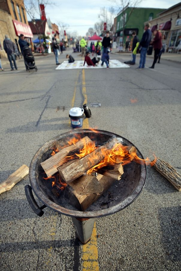 A fire burns on Main Street during Wauconda's Holiday Walk.