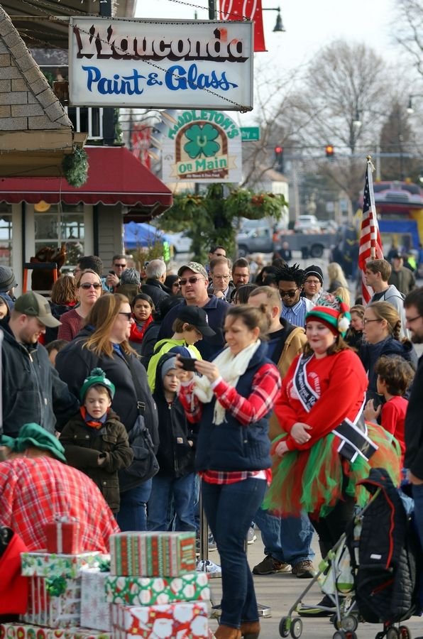 People line up to see Santa at Wauconda's annual Holiday Walk on Main Street Saturday afternoon.
