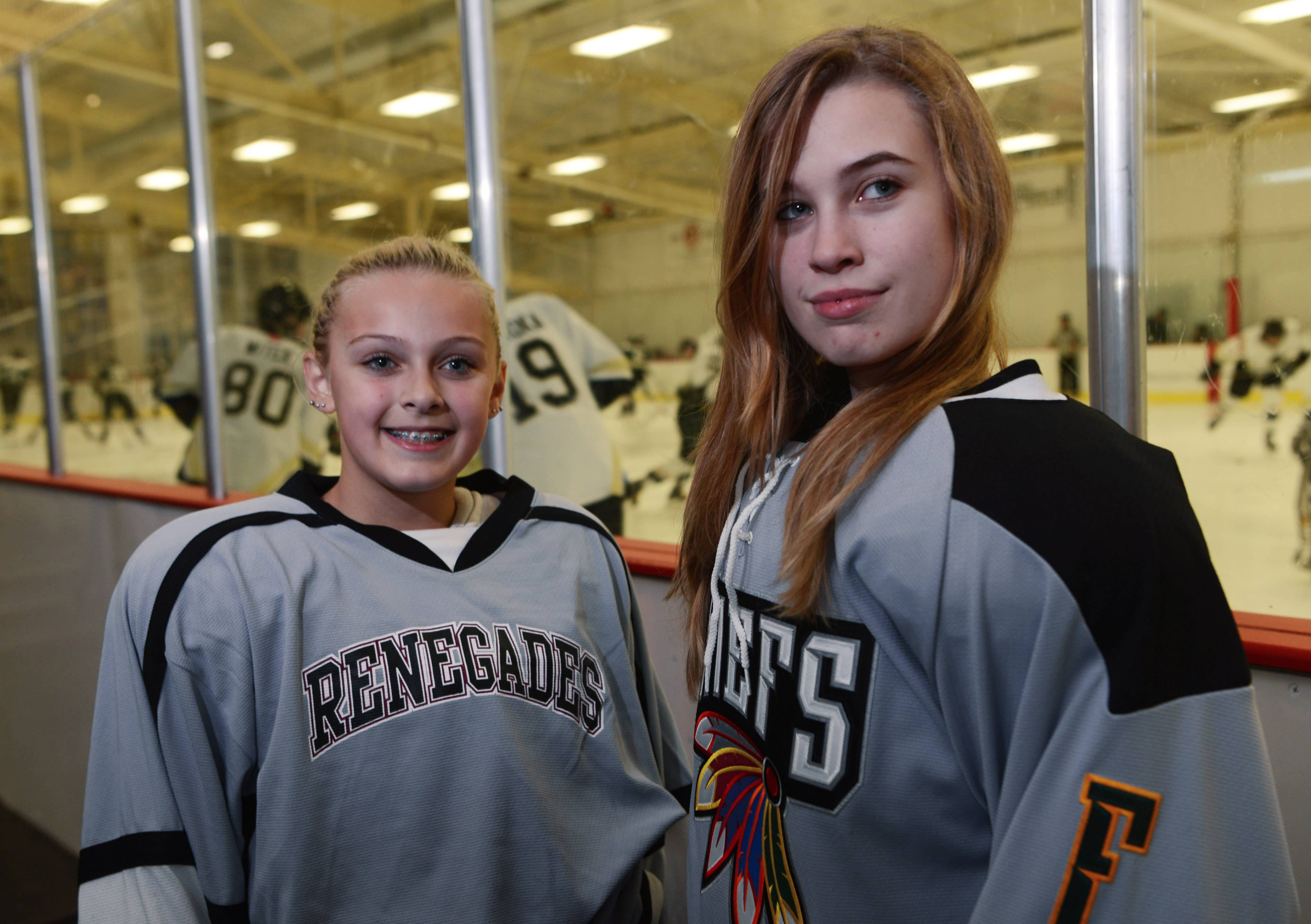 Eli Ternovits, 12, left, plays for a Rolling Meadows Renegades, while her sister, Drew, plays on a high school-level junior varsity team. Both girls play on teams that are otherwise all boys.