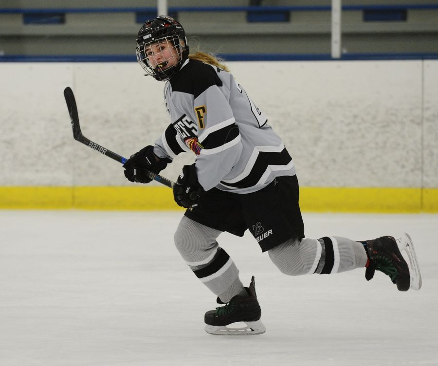 Drew Ternovits, a defenseman on the D211 Chiefs hockey team, plays in a recent game against Stevenson High School. The 16-year-old former figure skater started playing hockey when she was 7 years old.